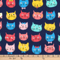 Kaufman Whiskers and Tails Slicker Laminate Cat Faces Navy